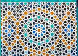 Moroccan zellige mosaic tilework on the wall, Medina of Fez, Morocco.