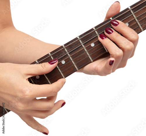 Girl playing an electric guitar on white background - 240607662