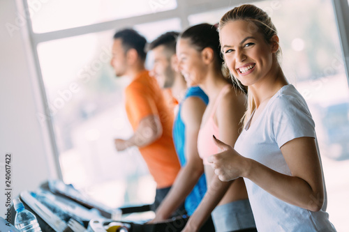 Young attractive woman doing cardio training in gym - 240617422