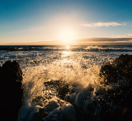 Splash against the rocks at sunset © Gabriele Maltinti