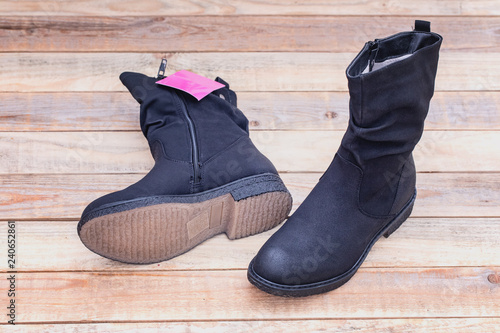 74a473092bf90a Genuine leather fur lined boots at wood background