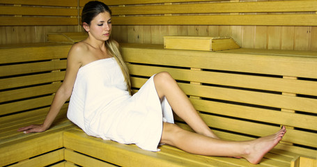 Young beautiful woman having a sauna bath in a steam room © Minerva Studio