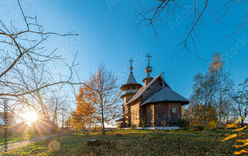 Wooden orthodox church in sunlight