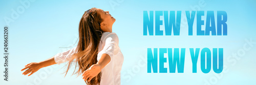 Leinwanddruck Bild New Year New Start happy woman with open arms in freedom and carefree banner panorama. Girl healthy, well-being concept on blue background.