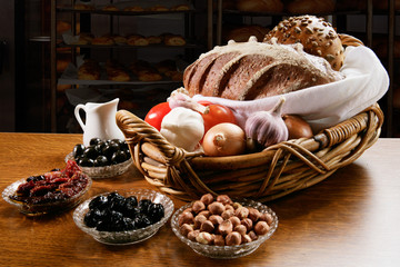 Basket with Freshly backed bread with various vegetables
