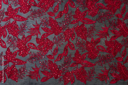 Red lace texture on wooden bakground - 240670641