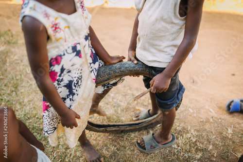 children playing with a tire in Uganda, Africa
