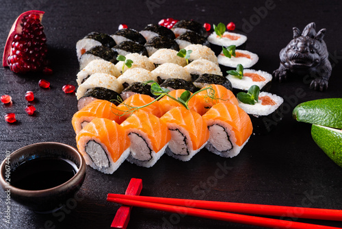 Foto Murales sushi on the black background