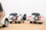 SUVs travel through desert dunes,  image out of focus