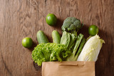 fresh vegetables in a brown paper bag - 240689605