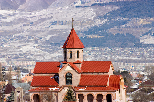 Surb Vardan church and Caucasus Mountains.