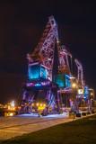 Illuminated old port cranes on a boulevard in Szczecin City at night