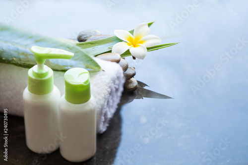 Leinwandbild Motiv Towel and cream tubes for treatment. Body care and spa concept