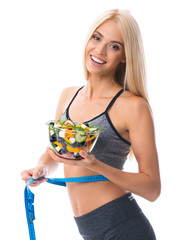 Woman in sportswear with tape measure and salad, isolated