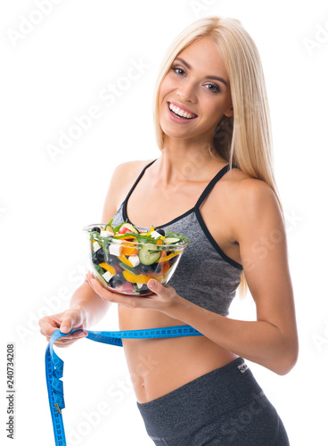 Woman in sportswear with tape measure and salad, isolated - 240734208