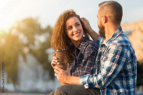 Leinwandbild Motiv Romantic feelings. Delighted man touching her wife's hair