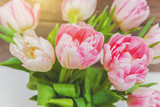 Spring greeting card. Bouquet of fresh light pastel pink tulips flowers on wooden background. Happy holiday easter mother day anniversary valentine day birthday concept. Flat lay top view copy space © Юлия Завалишина