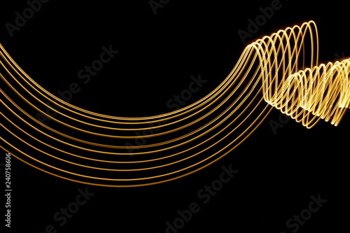 Light painting, long exposure photography, metallic gold color
