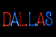Light painting. City name. DALLAS. Blue and red colors.