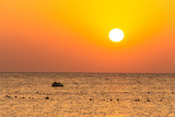 boat silhouetts on the shores of the red sea at sunset in Makadi Bay Egypt golden colors - 240768218