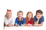 Full length portrait of cute little kids girls and boys in stylish clothes looking at camera and smiling against white studio wall. Kids fashion concept - 240770852