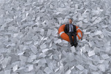 businessman are floating on the sea of paper