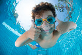 Fototapeta Łazienka - Underwater Young Boy Fun in the Swimming Pool with Goggles © Adnan
