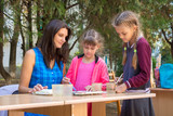The teacher at the master class gives drawing lessons - 240793205