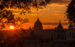 View of Rome historic center skyline with ancient domes and bell towers at sunset