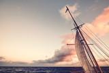 Sail at sunset, endless travel concept, color toned picture. © MaciejBledowski
