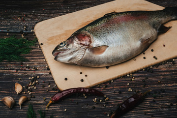 red fish on a wooden cutting Board . rainbow trout
