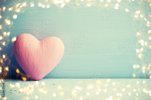 Living coral heart on the wooden background. Provencal style. © gitusik