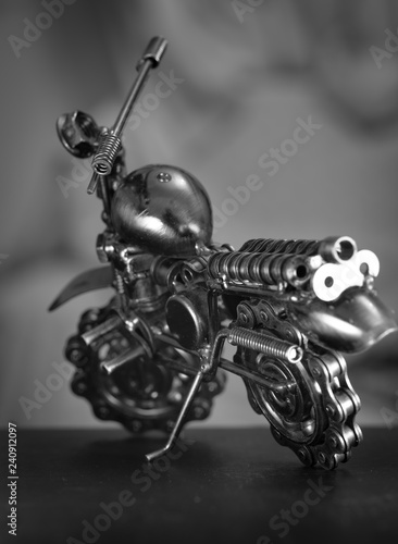 Close up (Macro) of Handmade metal toy motorcycle/motorbike made out of scrap metal pieces with short depth of view