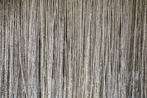 Curtain of shiny metallic silver chains. Texture