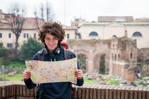 Sticker Handsome tourist looking at tourist map near Roman forum in Rome, Italy.