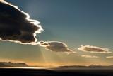 Reflection of sun shining behind cloud on Adriatic sea, mountain Biokovo and island Hvar on background, Dalmatia, Croatia - 240997017