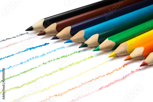 Colorful wooden pencils in row on white background
