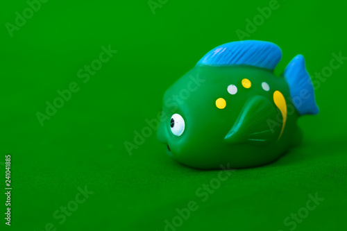 children's toy on a green background-fish  - 241041885