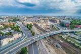 Fototapeta City - Panorama miasta z dworcem i budową wieżowca © Damian