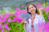 Researchers, women, are glad to succeed in pink orchid orchards in the garden for export.