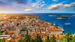 Leinwanddruck Bild - Hvar town with seagull's flying over city, famous luxury travel destination in Croatia. Boats on Hvar island, one of the many Islands near Dubrovnik and Korcula on the Dalmatian Coast of Croatia.