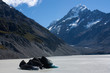 By the Hooker Lake, looking at the Mt. Cook at the Hooker Valley Track in the Aoraki / Mt. Cook National Park in the South Island in New Zealand