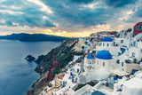 Churches in Oia, Santorini island in Greece, at sunset. Travel background. - 241089297
