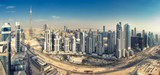 Aerial panorama view on downtown Dubai, UAE. Skyscrapers of the business bay on a summer day.