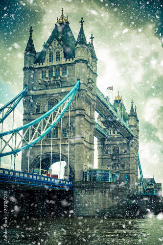 Winter at Tower Bridge London with snow falling on snowy day