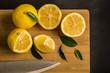 Yellow lemons  on  board - 241185289