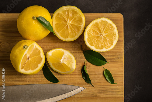 Yellow lemons  on  board - 241185289