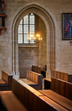 Arched entrance to the side chapel and benches. in Severin church in Erfurt