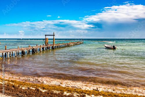 Foto Murales Steg im türkis farbenen Wasser