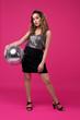 Stylish woman with disco ball